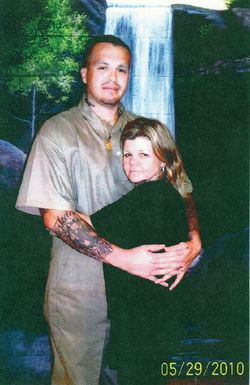 Arm-in-arm before a backdrop at the federal pen in Kentucky: New Mexican Mafia shot-caller Angel Garcia and his wife, Phoenix defense attorney Carmen Fischer.