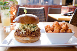 The kalua pork sandwich and sweet potato tots are two standouts at Tryst Café in North Phoenix.