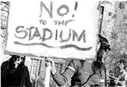 Protesters rally against a downtown stadium site.