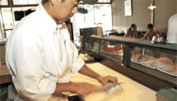 Cutting edge: Sushi maestro Kelvin Kim of Tokyo Lobby starting work on one of his mountainous Volcano rolls.