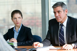 Solitary man: George Clooney (pictured with Anna Kendrick) lives an uncomplicated life in Up in the Air.
