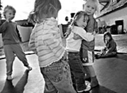 Tia gets a hug at play group.