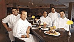 Too many chefs in the kitchen? With this much talent on deck, Caf&amp;Atilde;&amp;copy; ZuZu&#039;s grub should kick more ass: From left, Austin Chantos, Justin Beckett, Ron Dimas, executive chef Charles Wiley, and Sean Currid.