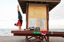 Victoria Jackson doing a handstand at a gig hosting a Christmas show on a Florida beach.
