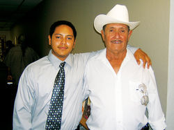 Julio Mora and his father, Julian, last year, after the ACLU filed suit on their behalf.