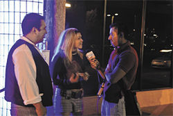 Obed Hurtado conducts an interview outside Club Rain in Scottsdale.