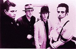 """Living in Fame"": The nattily dressed Clash. From left,  Paul Simonon, Joe Strummer, Topper Headon and  Mick Jones."