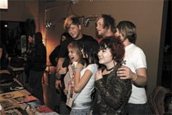It feels good to be loved: Back row, from left, Desole's Gavin Linderman, Lance Linderman and Jason Stromburg pose with fan girls at Oh Shit! A Fest?.