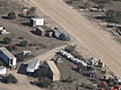 Two electric generators taken from Colorado City are partially hidden beneath tarps at YFZ.