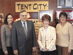 Sheriff Joe Arpaio poses with three members of the Arizona Department of Peace group, including Ann Marie Tate (far left).
