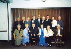 Portrait of a Baptism: J.T. Ready is center, front row; ex-state Senator Karen Johnson clasps Ready&#039;s arm, while state Senate President-elect Russell Pearce, top row, fourth from right, smiles for the camera.