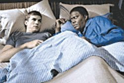 Strange bedfellows: Ashton Kutcher and Bernie Mac learn to form a father-son bond in Guess Who.