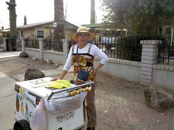 Times are tough for everyone in El Mirage, but Maria hopes to sell a few popiscles.