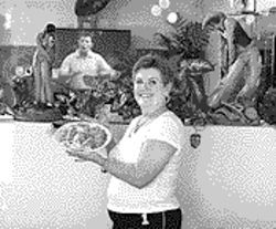 Cafe Santa Fe owner Carla Mollica cooks a killer chile chicken casserole.