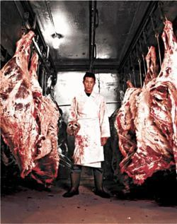 Kaz Yamamoto in the storage area of his home kitchen.