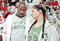 Coach potato: Martin Lawrence (with Tara Correa-McMullen) is neither dirty nor funny in Rebound.