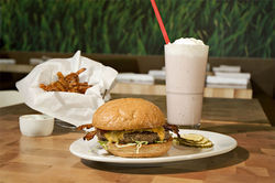 Properly decadent burgers, fries, and shakes at Zinburger await hungry shoppers at Biltmore Fashion Park.